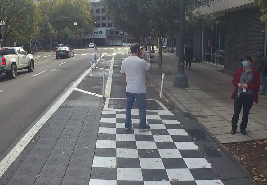 man on phone in bike lane Broadway 10-30-2020